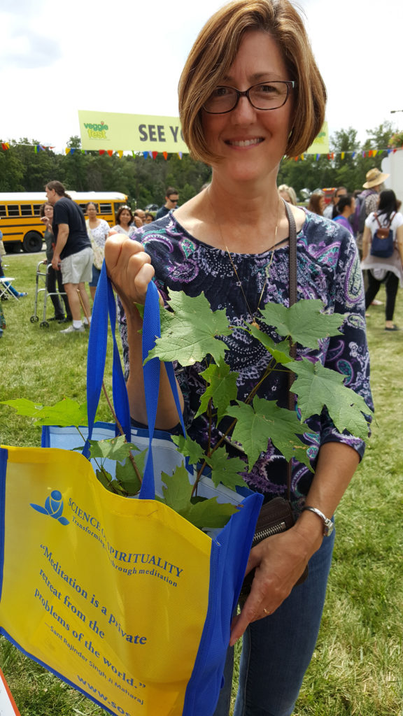 This smart woman who used her Veggie Fest bag to carry her new tree, as did many others.