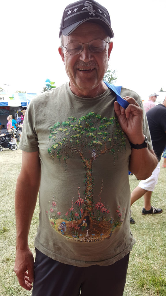 "A gentleman with a GREAT T-Shirt who really ""gets"" the tree thing."