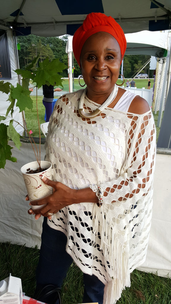 A lovely lady who grows food for her community in her garden. Now she will have a tree there, too!